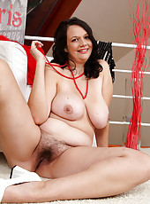 Elegant housewife Rea White strips and spreads her hot hairy pussy