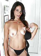 47 year old and elegant wife Stacy slips off her clothes for naked play