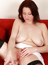 34 year old Carol from AllOver30 firmly plants a large glass dildo inside