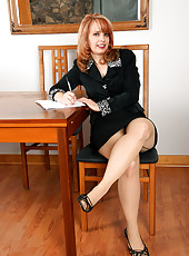 Redheaded office MILF Pandora Jones from AllOver30 getting sexy