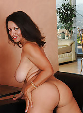 53 year old brunette Persia posing and pulling at her mature pussy hair