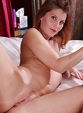 39 year old petite Sky Rodgers starts toying of her mature pussy
