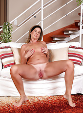 MILLF next door Laura G deeply explores her pussy on the couch