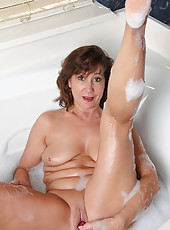 Sexy 53 year old Lynn from AllOver30 enjoying a waterproof vibrator