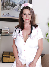 Gorgeous and busty MILF Christy from AllOver30 playing horny nurse