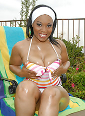 This hot ebony babe is gettin her fine titties all creamed up in these hot pics