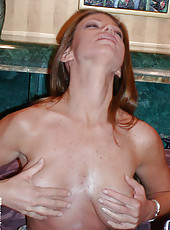 Amazing big tits have some cum rubbed on them