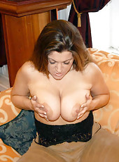 Long haired bueaty pushing her panties to the side
