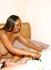 Ebony babe flashes her big tits and plays with pussy