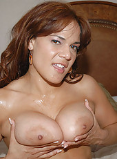 Sexy big tittied babe gets her first cum bath here in these hot pics