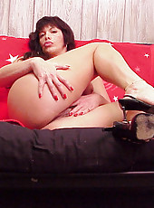 Mature housewife shows off her apple bottom and her huge funbags