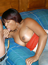 Black amateur uses her huge tits for a oily tit fuck