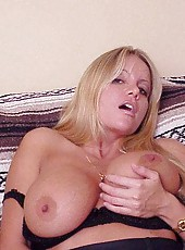 Playing with a tight snatch while grabbing this blondes huge tits