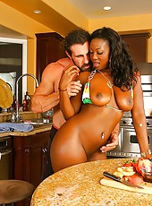 Hot round and brown babe aryana gets caught materbating in the kitchen on the kitchen table in these hot cock riding pics