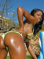 This sexy ebony babe dives out of that hot green bikini in an instant in these hot pics