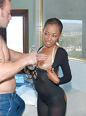 Sexy ebony babe in a hot body suit gets poked from behind in these pics