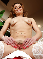 Mature Suzy Losson from AllOver30 spreading her tight ass wide