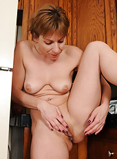 Petite 39 year old housewife Brandi Minx spreads in the hitchen
