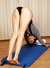 Hairy pussied and petite Kitty McMuffin performing some naked yoga