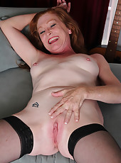 Redheaded 28 year old Tami Estelle looking sexy in her black lingerie