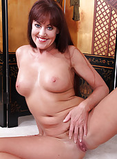 Redheaded MILF Shauna takes off her uniform to show off her pussy