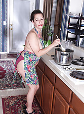 43 year old busty MILF Christy has some fun cooking in her kitchen
