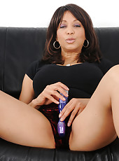 50 year old and exotic Lala Bond slips a purple toy deep inside her