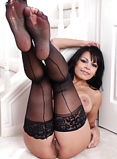 Exotic and elegant Lola strips naked and spreads her sexy long legs