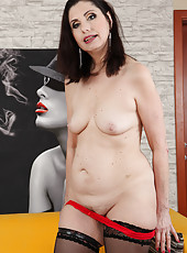 Sexy 56 year old stunner Barbarella spreading her tidy pussy in here