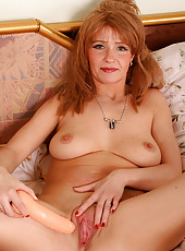 Redheaded MILF plays and gets off with her rubber vibrator