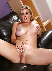 Big titted blone MILF Kala plays with her damp shaven pussy