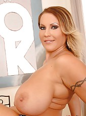 Busty Legend Toys With A Vibrator