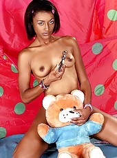 Hot black doll licking and sitting on dildo