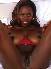 Dark skin whore shows off her big saggy breasts
