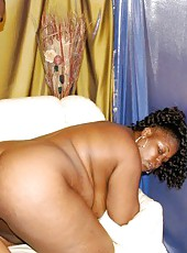 Fat black biotch getting her pussy pounded on the sofa