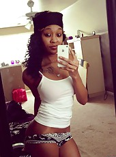 Photo gallery of a sexy black babe selfshooting at home