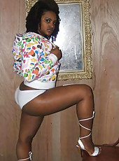 Sexy ebony babe with curves posing in different outfits