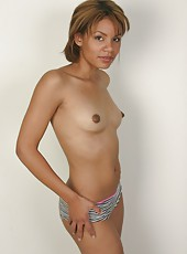 Young and slender black girl gets naked