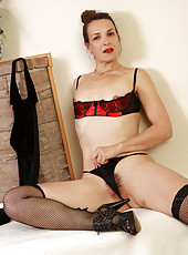 Gorgeous 41 year old brunette Fefe shows off her small tidy pussy