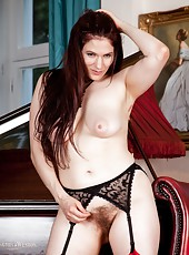 British brunette hairy girl Brianna Green is 34D, making her tits hard to resist. Once she looses her red rose dress though it