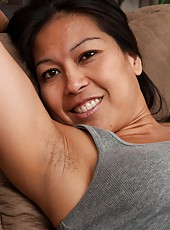 Max Makita is a hairy girl that loves to show off her sexy body as she sits on the couch and has a glass of wine She seductively strips out of her clothes and spreads her legs apart to show her pussy.