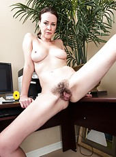 Veronica Snow is a sexy brunette business woman who gets hot and horny at work and strips naked. She shows off her hairy pussy and then slides her long fingers in and out of her warm wet pussy.