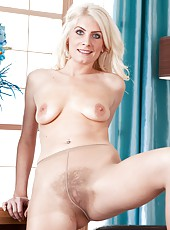 When hairy girl Ashleigh McKenzie gets dressed up, she loves wearing pantyhose. She loves them because they turn her on and she has to strip her pretty clothes off to play with her hairy wet pussy.