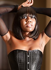 Nina Devon has a photo shoot in a pretty black dress. She likes to show her really nice ass, but more than that she likes to sit on the floor naked showing her hairy pussy and masturbating.