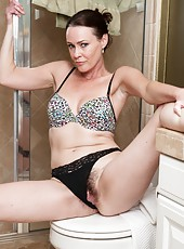 Hairy woman Veronica Snow is a sexy brunette getting ready in the morning as she takes off her lingerie and then gets her hairy pussy wet and soapy as she takes a shower and shows off her snatch.