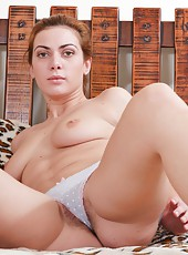 Exotic Edica and her hairy pussy are going to be spread wide open when she takes off her clothing only to spread her hairy pussy. She loves to show off the pink perfect pussy that is hairy.