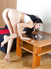 Mia is a pretty dark haired beauty, but she also loves to take off her panties to show off her hairy pussy. She can rub herself warm, but the help of a few candles never hurt her hairy pussy one bit.