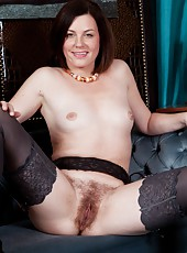 Sofia Mathews likes the big pictures of her favorite old cars on the walls. She gets turned on every time she walks in the room. So she does a very sexy strip dance and plays with her hairy pussy.