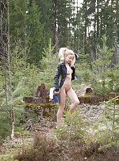 Lisa T is taking a walk in the woods when she decides to go au natural. She takes off her denim skirt and rubs her hairy body out in the woods where anybody walking by could see her hairy pussy.