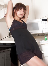 Ivan is finishing up the dishes. She stretches and rubs her hairy body, from her pits to her pussy, which she finds to be incredibly wet. She hops on the counter and gets hands on in this hairy porn.